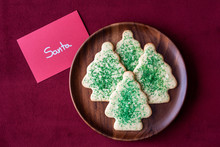 Christmas Sugar Cookies For Santa On A Wood Plate, Note To Santa, Red Fabric Background