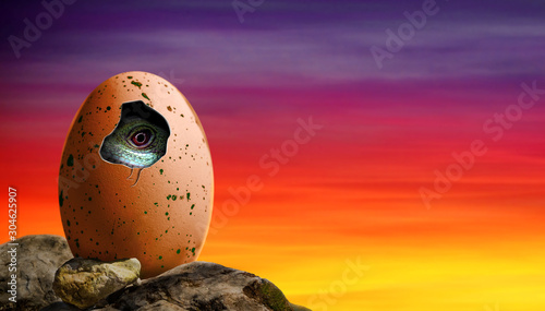 Dinosaur egg in a cliff hatching with baby dinosaur inside the egg Canvas Print