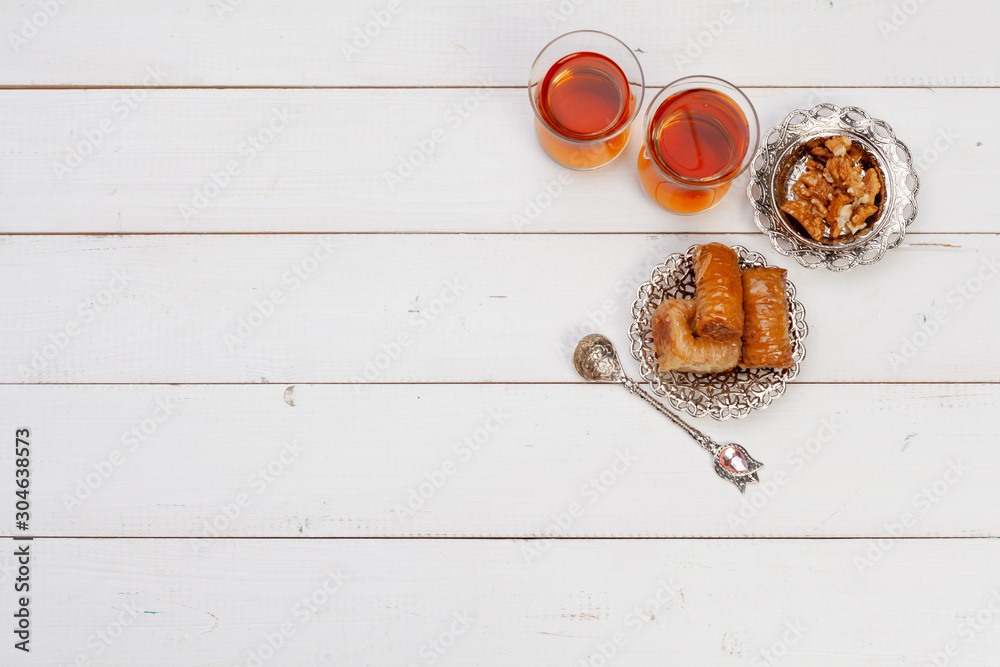 Fototapety, obrazy: Cup of hot tea and a plate of turkish desserts