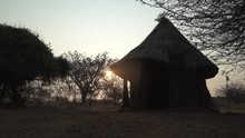Silhouette Of African Hut