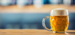 Mug of cold beer on bar counter in pub or restaurant