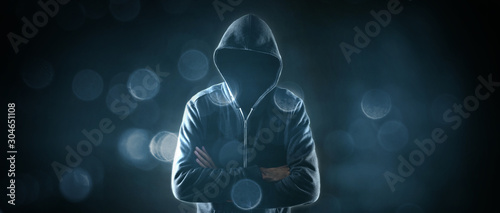 Fotomural Cybersecurity, computer hacker with hoodie