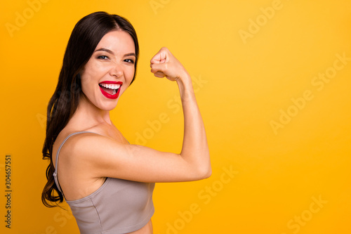 Side profile close up photo of cheerful strong powerful woman demonstrating her Canvas Print