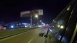 Driving Car On Street City At Dark. Time Lapse. Evening Street Lights. Camera In Front, Windshield Reference. Hyperlapse. Driving Car POV On Road Urban In Of Night In With Bright Lights Traffic.