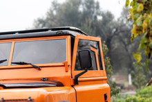 Vintage Orange Color 4x4 Off-road Car, The Car Is Old And Has Been Modified.