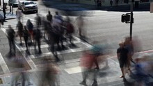 Crowded Pedestrians Crossing The Street Crosswalk With Driving Cars