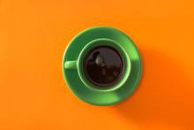 Green Cup Of Coffee On Orange ...