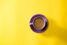 Purple Cup Of Coffee On The Ye...