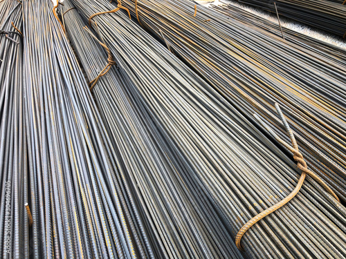 Photo Steel reinforcement rebars tied with metal wire at the outdoor warehouse