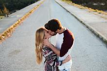 Sensual Lovers Kissing On Bridge