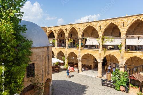 Fotografiet Lefkosia (Nicosia), Cyprus, Greece- AUGUST , 6 2019: view of the Buyuk Han (the