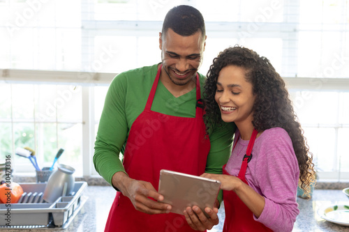 Couple in kitchen at Christmas