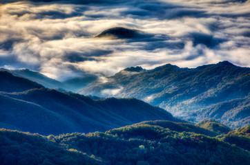 Fototapeta Wschód / zachód słońca Amazing Sunrise Over Misty Landscape.