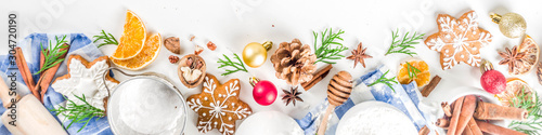 Tuinposter Bakkerij Christmas baking background. Christmas sweet cooking ingredients on white table. Ingredient for cooking christmas pastry, cookies and cakes, Flatlay on white table, top view with copy space
