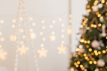 Beautiful Holiday Decorated Room With Christmas Tree And Bright Lights , Out Of Focus Shot For Photo Background. Blur Christmas Background