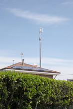 Roof House Wiht Solar Panels  And Telecommunication Tower With Copy Space For Your Text