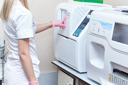 Photo automatic blood test analyzer in a medical laboratory.