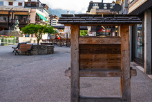 Old Wooden Blank Billboard With Empty Space In Chamonix Mont Blanc Village, France. Billboard Blank For Outdoor Advertising Poster Or Blank Billboard For Advertisement.