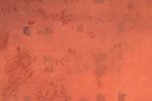 Grunge Orange And Red Metal Wall Of Factory Door Texture Background.