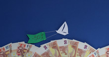 A Ship Is Sailing With A Flag With The Text Discount Minus 50 Percent