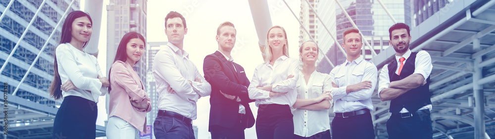 Fototapeta Group of Business people team work mix race standing confidence arm crossed wide for banner background.