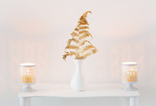 Interior Decor With Burning Candles On White Wooden Shelf