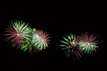 Flashes Of Green, Red And White Fireworks