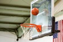 Basketball Hitting Backboard Aimed For Net