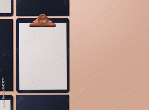 Fototapeta Realistic mockup. Clipboard with sheets of paper on nude background. Template for branding identity. Blank objects for placing your design. 3D illustration. obraz