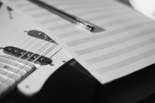 Vintage Guitar And Stave Closeup . Black And White