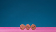 Three Wooden Cut Circles With Contact And Communication Icons