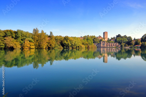 adda river with trees and reflections in italy Canvas Print