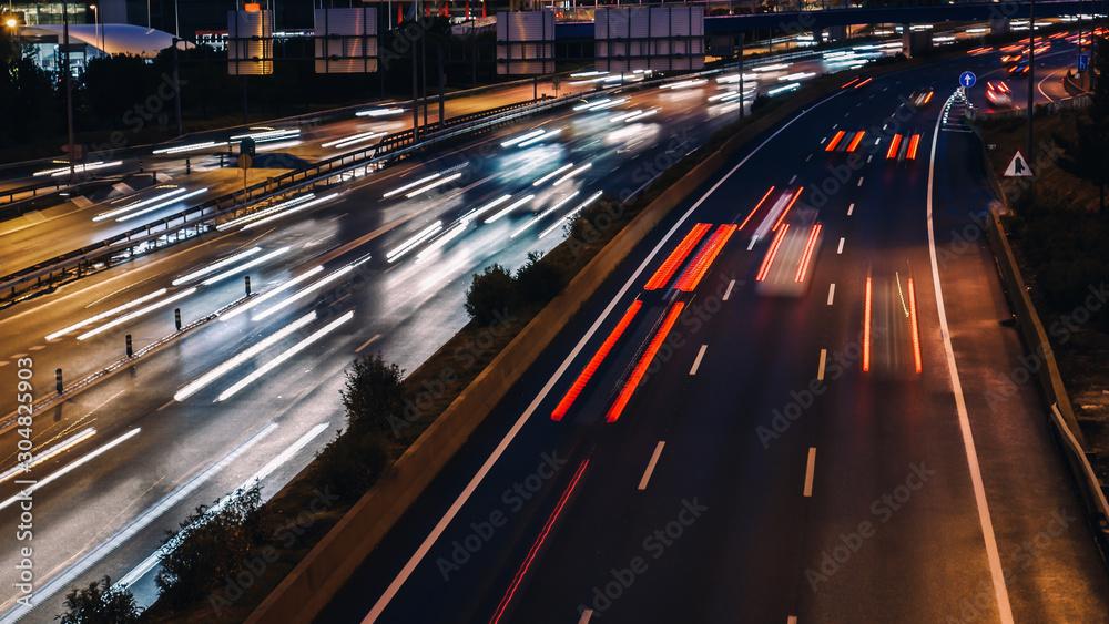 Fototapeta speed morning traffic motion blur in generic highway