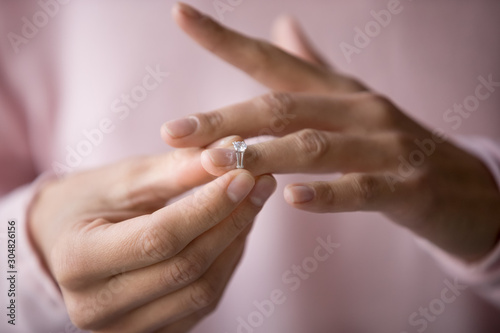 Close up of woman removing ring filing for divorce Wallpaper Mural
