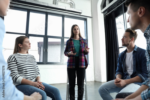 Obraz Psychotherapist working with patients in group therapy session indoors, low angle view - fototapety do salonu