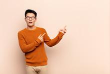 Young Chinese Man Feeling Joyf...