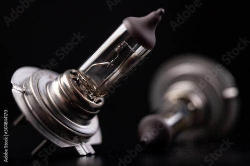 Obraz Blown car bulbs on a dark table. Spare parts for passenger cars. - fototapety do salonu