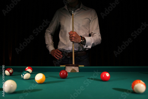 Foto Sports game of billiards on a green cloth