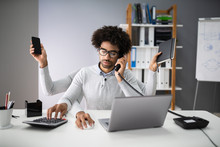 Multitasking Businessman In Office