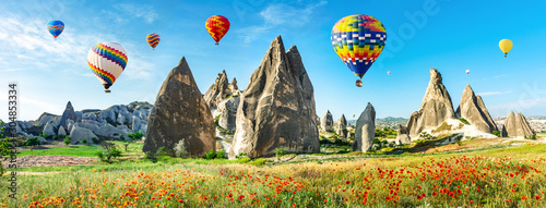 Travel concept. The great tourist attraction of Cappadocia - balloon flight. Cappadocia is known around the world as one of the best places to fly with hot air balloons. Goreme, Cappadocia, Turkey. Ar