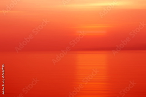 Foto auf AluDibond Rot Abstract background motion blur sunset on the sea