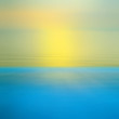 canvas print picture - Motion blurred background of refraction in the sea