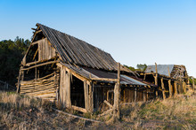 Ruins Of An Old Wooden Barn Made From Rustic Logs And Planks