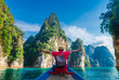 canvas print picture Man traveler on boat joy fun with nature rock mountain island scenic landscape Khao Sok National park, Famous travel adventure place Thailand, Tourism beautiful destinations Asia holiday vacation trip