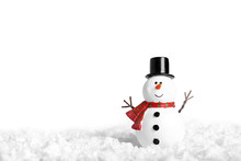 Toy Of Snowman On Snow Over Wh...