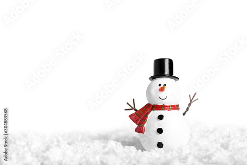 Obraz na plátně Toy of snowman on snow over white background