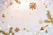 Leinwanddruck Bild Merry Christmas and New Year background. Xmas holiday card made of flying decorations, gold fir branches, balls, snowflakes, sparkles, gift boxes, bokeh, light on golden background. Selective focus