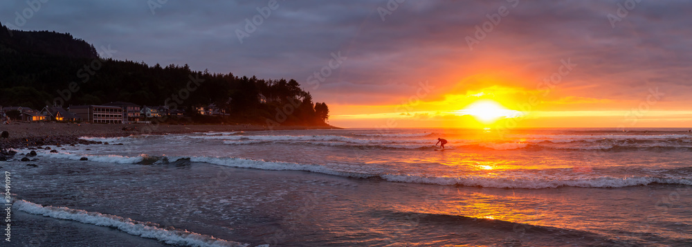Seaside, Oregon Coast, United States of America. Beautiful Panoramic View of a Rocky Beach on the Pacific Ocean during a dramatic summer sunset.