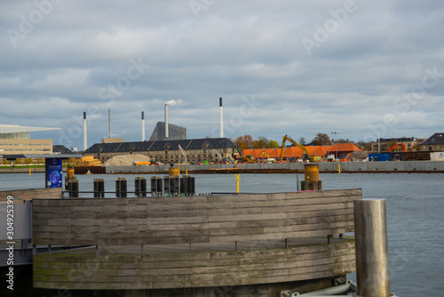 COPENHAGEN, DENMARK: Beautiful panoramic view from the waterfront to the buildings and the river Wallpaper Mural