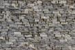 Texture of an old damaged wall made of rectangular blocks